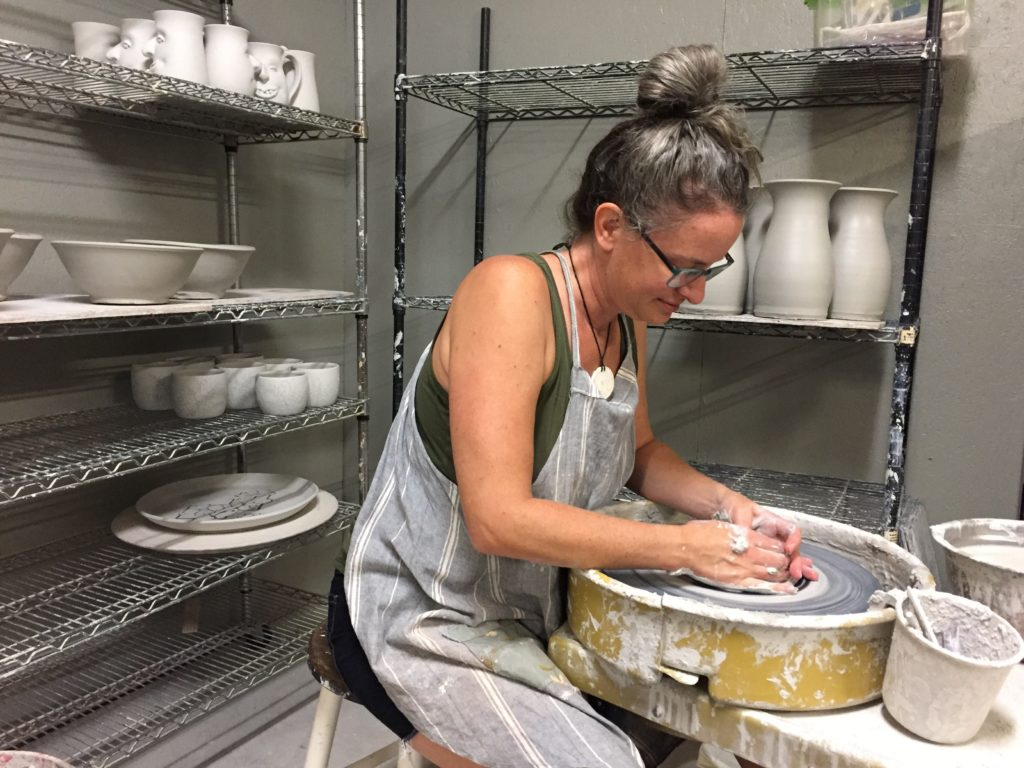 Meghan Bernard at the pottery wheel.